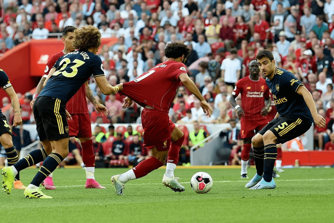 Mohamed Salah wins a penalty against Arsenal at Anfield